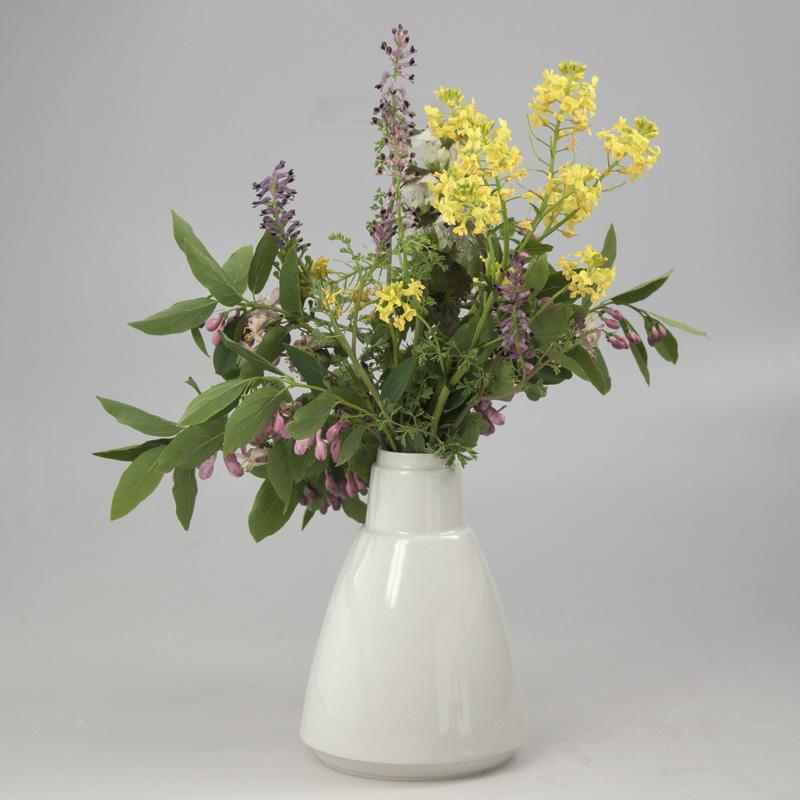 Vase Seechen mit Blumens